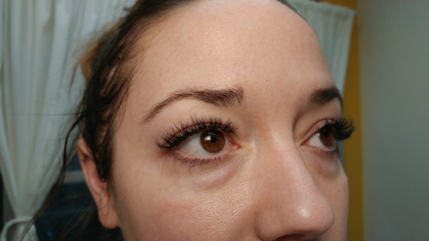 happy client with new eyelash extensions